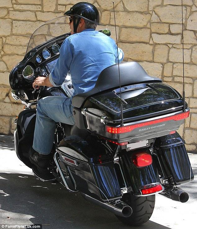 George Clooney on his Motorbike in LA Dd10