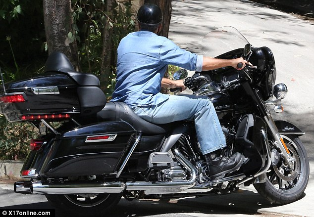 George Clooney on his Motorbike in LA Dd210