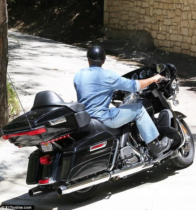 George Clooney on his Motorbike in LA Dd310
