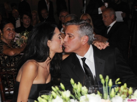 George Clooney and Amal to visit the Celebrity Fight Night Foundation in Florence - Page 4 Kiss12