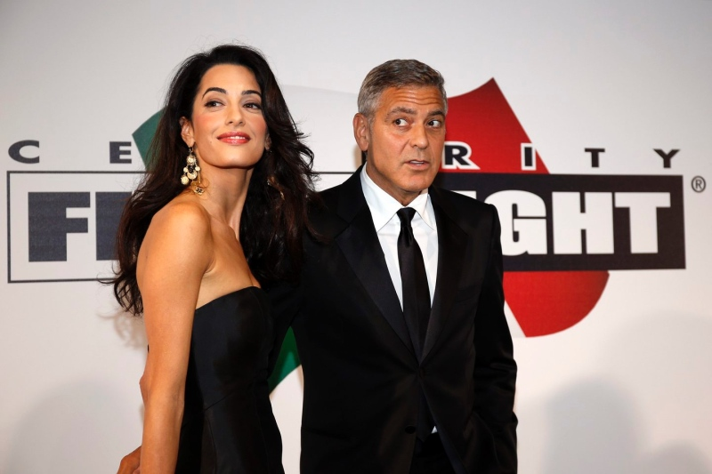George Clooney and Amal to visit the Celebrity Fight Night Foundation in Florence - Page 2 Tata10