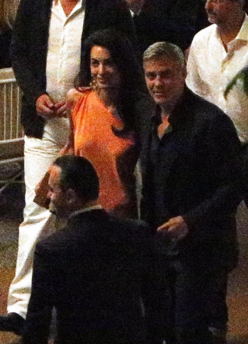 George Clooney and Amal dining at Villa d'este in Lake Como, Italy, on Aug. 29. 2014 Tisch210