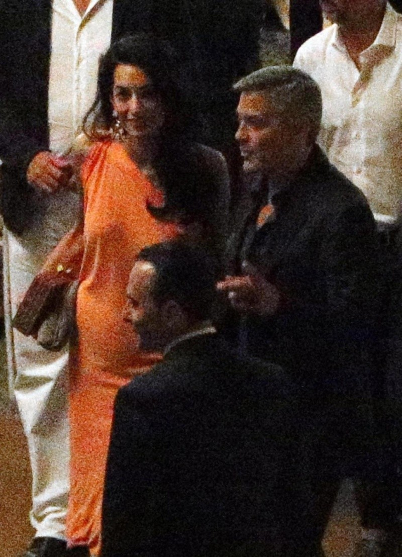 George Clooney and Amal dining at Villa d'este in Lake Como, Italy, on Aug. 29. 2014 Tisch310