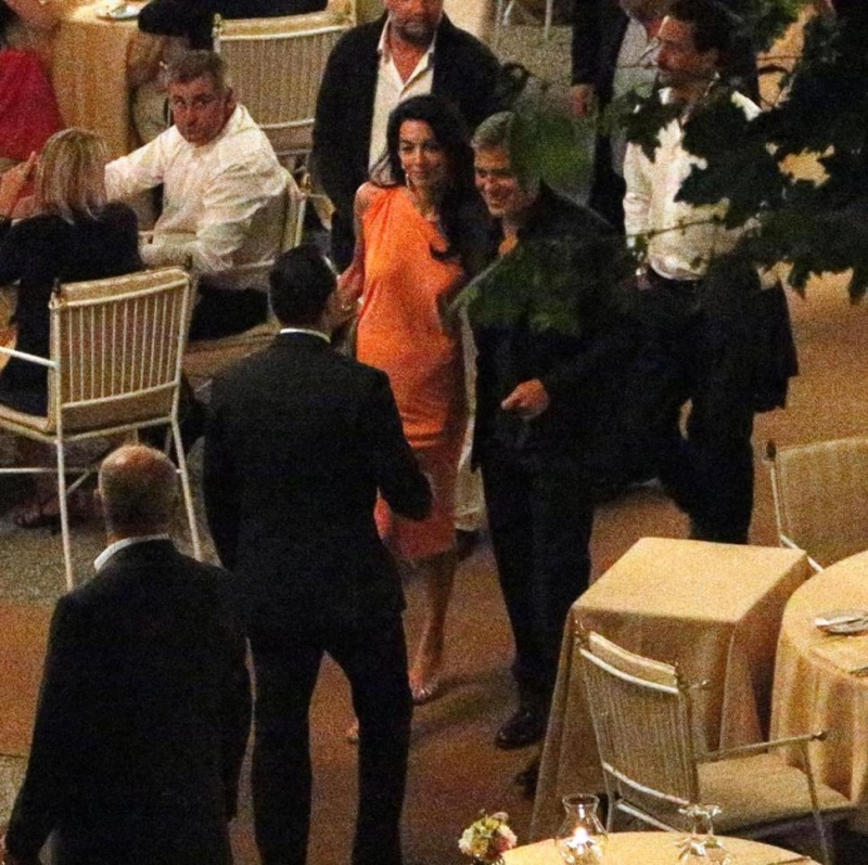 George Clooney and Amal dining at Villa d'este in Lake Como, Italy, on Aug. 29. 2014 Tisch510