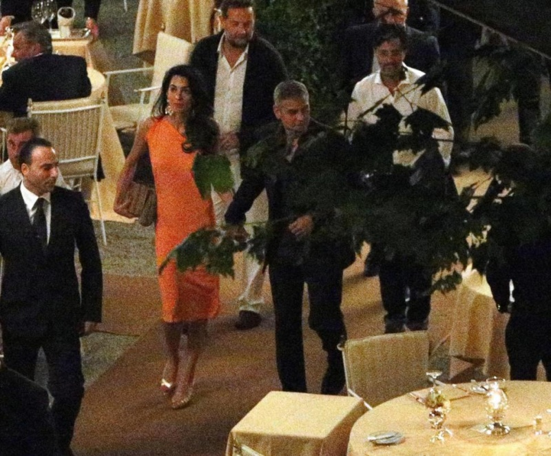 George Clooney and Amal dining at Villa d'este in Lake Como, Italy, on Aug. 29. 2014 Tisch710