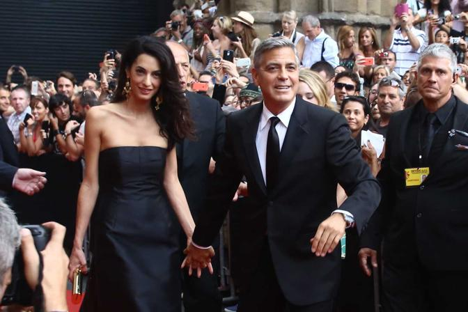 George Clooney and Amal to visit the Celebrity Fight Night Foundation in Florence - Page 2 Yap710
