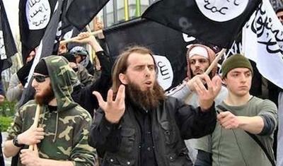 أوصاف كلاب الدجال ( مقاتلي دولة العراق والشام السفيانية ) المعروفة بـ ( داعش )  Uooo_o12