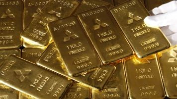 Gold posts weekly loss on dollar rise, strong US data  Gold1_10
