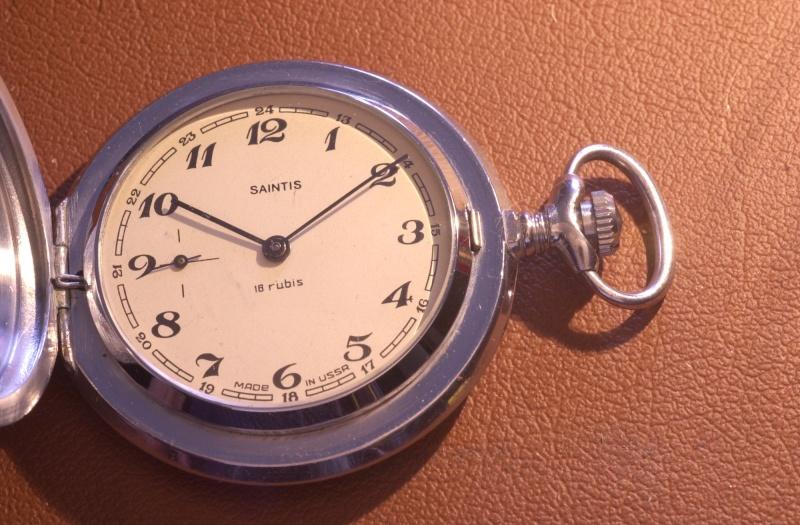 Marques d'emprunt ou d'exportation des montres soviétiques - Page 2 Sainti10