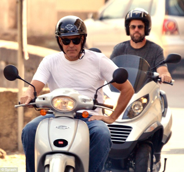 George Clooney puts safety first - buys new motorcycle helmet Motorb16