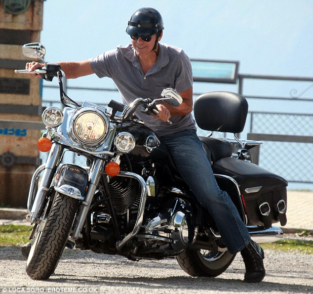 George Clooney puts safety first - buys new motorcycle helmet Motorb17