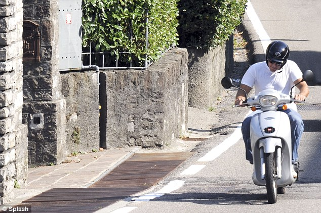George Clooney puts safety first - buys new motorcycle helmet Motorb18