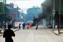 Combien ont coûté à Haiti les  deux coups d'état contre Aristide  ? 37761611