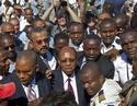 Combien ont coûté à Haiti les  deux coups d'état contre Aristide  ? Images22