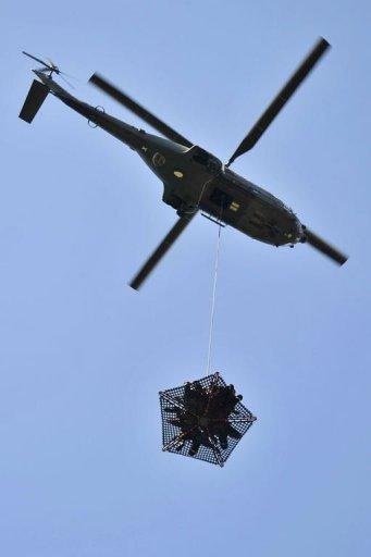 Une nacelle héliportée, nouvelle arme de la Sécurité civile pour sauver des vies(Source AFP) Sacuri10