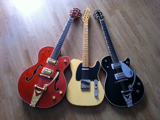 Welcome to the new forum, tell me about your rocking geetar! 3_guit12