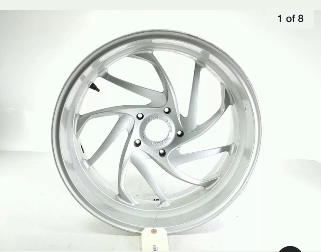 So I'm not the first, but can't find if mounting the 5 lug rear k1200 wheel has been solved 43b72010