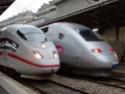 Photo gare + train + tramway à Paris. Hpim0611