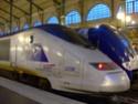 Photo gare + train + tramway à Paris. Hpim0623