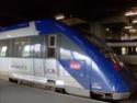 Photo gare + train + tramway à Paris. Hpim0642