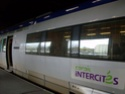 Photo gare + train + tramway à Paris. Hpim0643