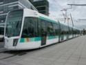 Photo gare + train + tramway à Paris. Hpim0710