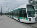 Photo gare + train + tramway à Paris. Hpim0712