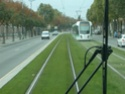 Photo gare + train + tramway à Paris. Hpim0716