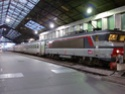 Photo gare + train + tramway à Paris. Hpim0812