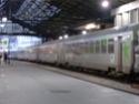 Photo gare + train + tramway à Paris. Hpim0813