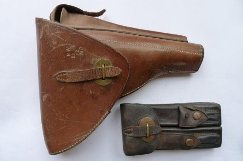 Les étuis et accessoires des Luger hollandais. Holste50