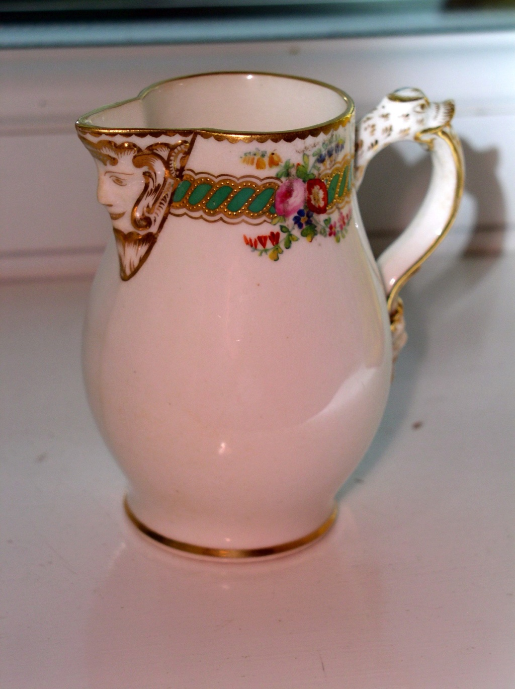 Delicate little cream jug with mask spout??Unmarked P1010815