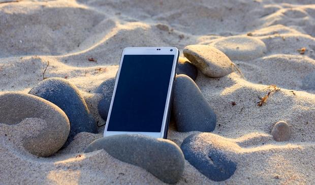 A quelle fréquence consultez-vous votre tél. à la plage? Cell-110