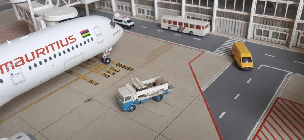 Réalisation de la maquette 1/144 d' un aéroport international (scratch) - Page 18 20200743