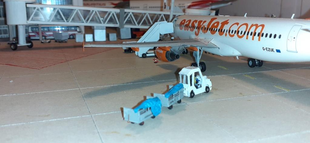 Réalisation de la maquette 1/144 d' un aéroport international (scratch) - Page 19 20200987