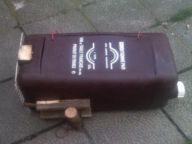 Fabrication d'une boite avec piège x destinée a la régulation d'une fouine Bidon_10