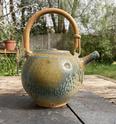Teapot with impressed shells. tadpole or hook mark: Reid Ozaki, USA  74b68210