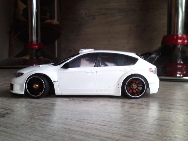 Mon garage: Twingo rs, 207 rc cup, citroene ds wrc, subaru wr P1102110