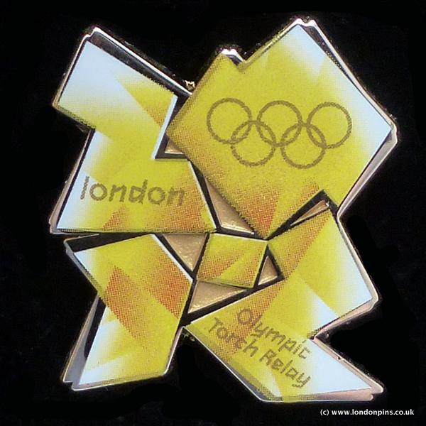 Pin's Londres 2012 - Relayeurs de la Flamme Olympique Transl10