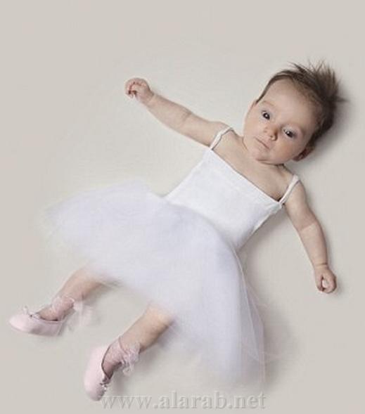 بالصور : فرنسي يتخيل مستقبل رضيعته من راقصة باليه إلى جزارة 20120314