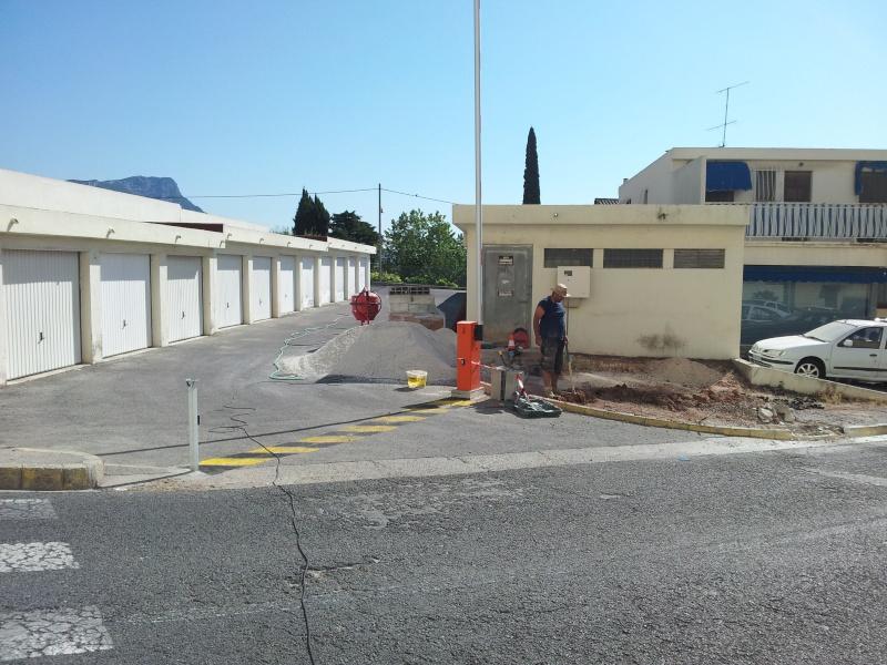 TRAVAUX DE FERMETURE ET DALLE A L ENTREE DES GARAGES 20120711