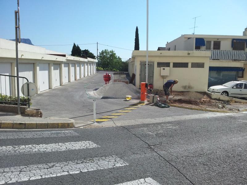 TRAVAUX DE FERMETURE ET DALLE A L ENTREE DES GARAGES 20120712