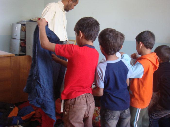توزيع ملابس 312