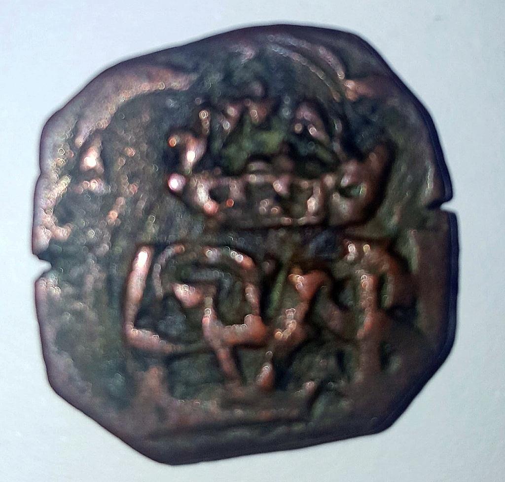 8 maravedís a martillo de Felipe III o IV, resellados. 211