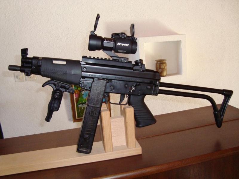 A force de réduire la longueur de canon des fusils d'assaut… - Page 3 Photo-12