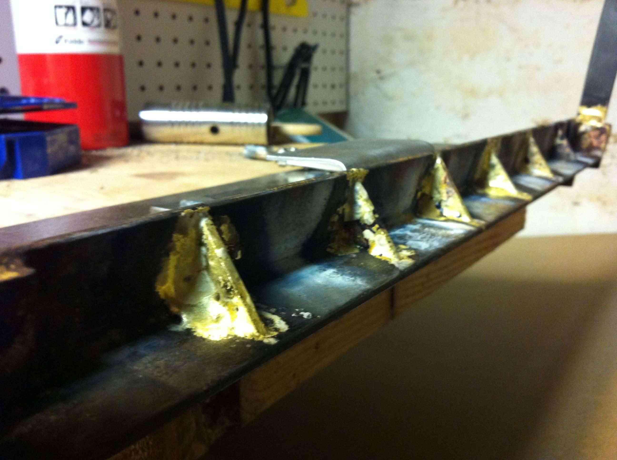 Sheet metal work in crossbow building Photo211