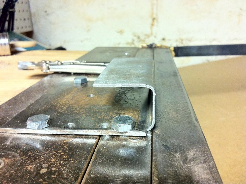 Sheet metal work in crossbow building Photo411