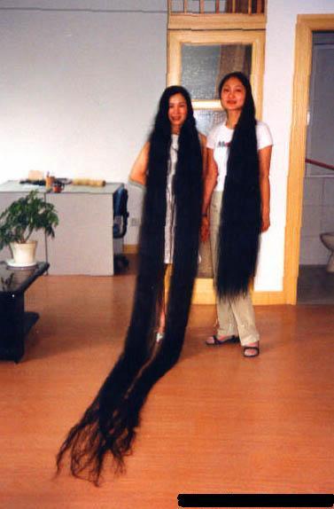أطول شعر امراة ي العالم واطول شنب رجل في العالم 39_17311