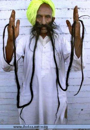 أطول شعر امراة ي العالم واطول شنب رجل في العالم 39_17712