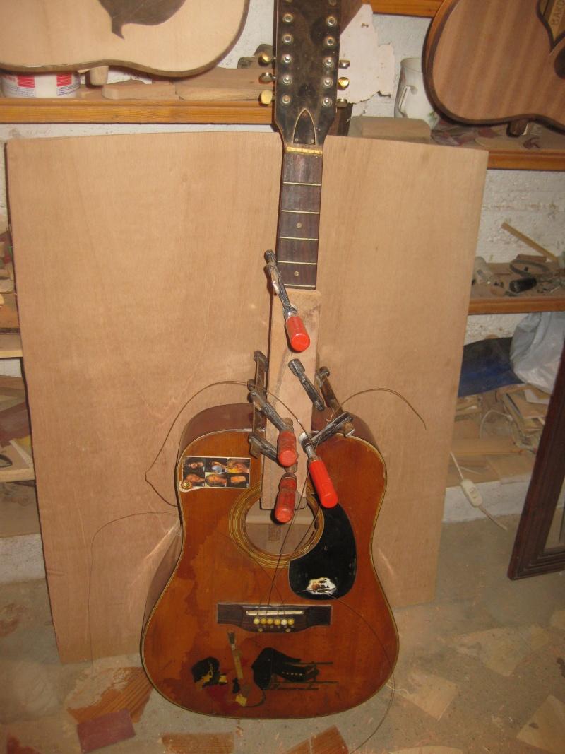 Une guitare vue du ciel en hommage à sa femme Img_0913
